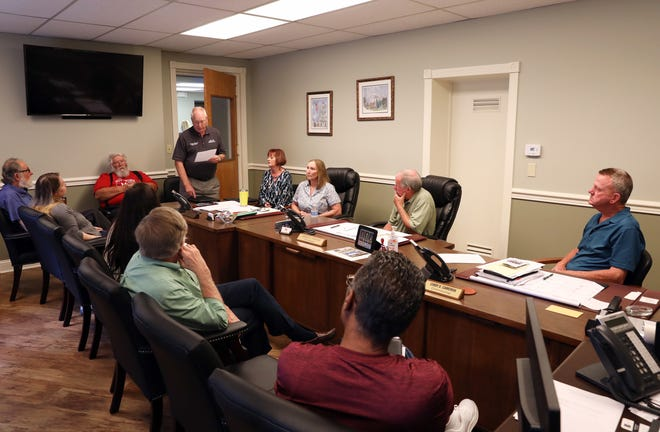 Muskingum County Land Bank Chairman Tim Smith reads a statement during a meeting of the Muskingum County Land Bank on Tuesday. The board voted to suspend the bank until various parties can agree on the proceedures by which the lank bank operates.