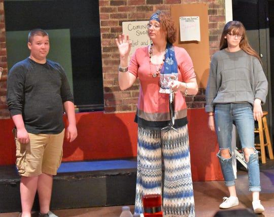 "Drew Hartley, Monica Van Nort and Liddie Bugglin in a scene from ""High School Musical."""