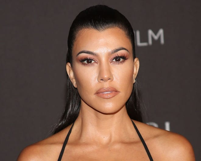 Kourtney Kardashian didn't want to let Menstrual Hygiene Day go by without celebrating it with a swimsuit photo.