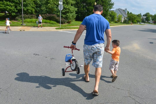 A father with his son near their home in Ashburn, Virginia, in June 2014.