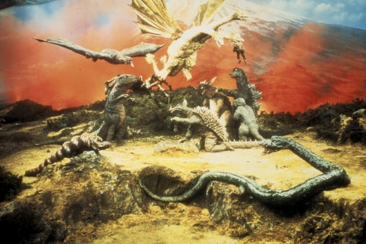 """Three-headed golden dragon Ghidorah (top) threw down with Godzilla and a whole host of giant creatures in 1969's """"Destroy All Monsters."""""""