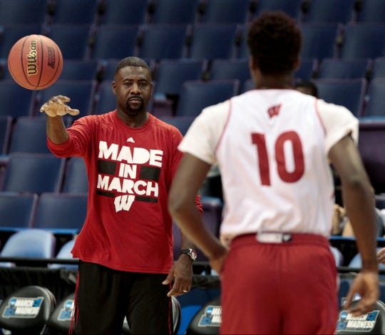 Howard Moore, left, shown with Badters forward Nigel Hayes during in 2016.