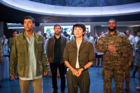 "Kyle Chandler (from left), Thomas Middleditch, Ziyi Zhang and O'Shea Jackson Jr. are just humans living in Godzilla's world in ""King of the Monsters."""