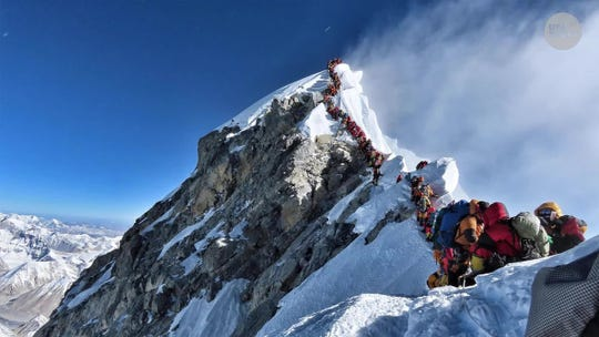 Another American dies climbing dangerously crowded Mount Everest