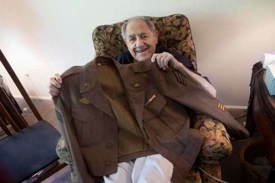 Mario Sorrentino shows off his Army jacket from from World War II.