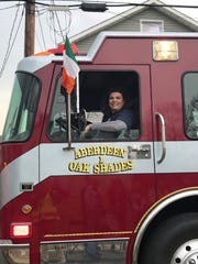 Sandra Lynch in a truck of Aberdeen Township Hose & Chemical Station No. 1
