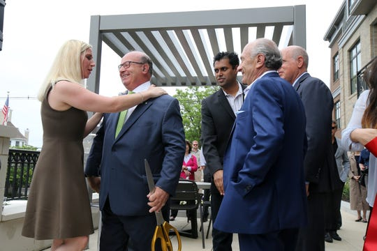 Debra Tantleff, TANTUM Real Estate President, hugs Red Bank Mayor Pasquale Menna during the opening of The Element, a new high-end 35 unit apartment complex along the Navesink River in Red Bank, NJ Wednesday May 29, 2019.