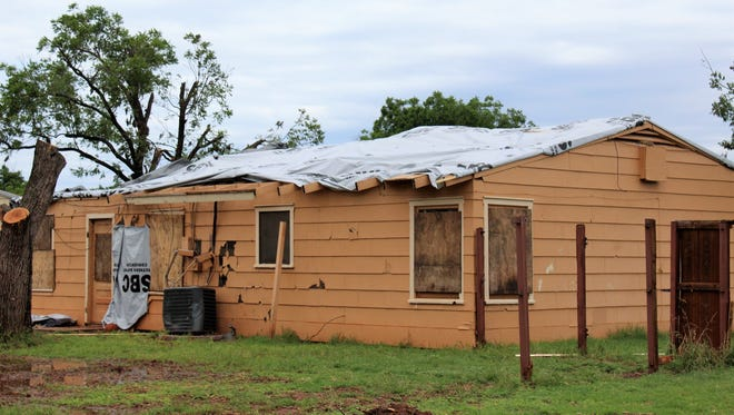 A view of the back of the home in which Tenille Woodard was living at the time of the May 18 tornado. Missing is her roof and the backyard fence. May 29 2019