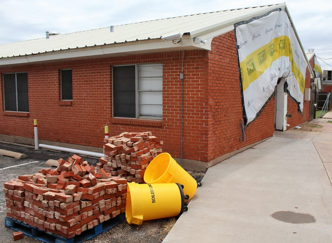 The north side of Willow Springs Health & Rehabilitation Center remains covered in places, with bricks stacked to one side Wednesday afternoon. Residents have returned after being displaced after the May 18 tornado in west Abilene. May 29 2019