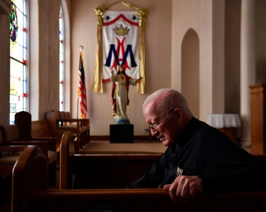 Monsignor Robert Bush in the sanctuary at Sacred Heart Catholic Church on May 23. After 23 years, Bush, 75, will step down as priest as the central Abilene church.