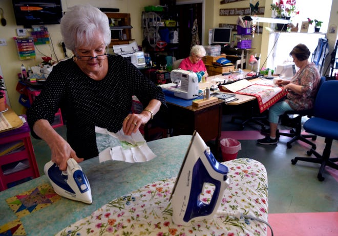 Nita Rannefeld irons a quilt block at R Quilt Haven on May 14. The Abilene Quilters Guild will hold 8ts Stars Over Abilene 25th Regional Quilt Show next weekend at the Abilene Convention Center.