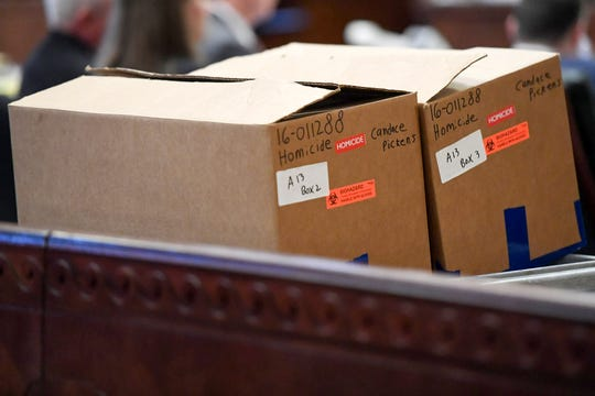 "Candace Pickens' name is seen on a box labeled ""homicide"" during opening statements May 29, 2019."