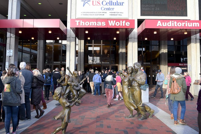 """Fans make their way into the U.S. Cellular Center's Thomas Wolfe Auditorium for """"Extreme Weather: A Conversation with Bill Nye"""" on April 1, 2019. A bid by Harrah's Cherokee Casino was accepted for the naming rights of the U.S. Cellular Center and the name change will take effect in 2020."""
