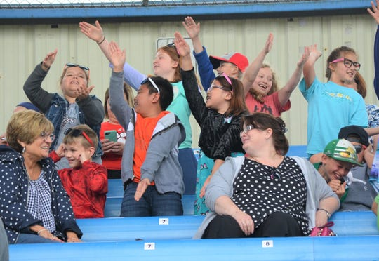 Among the crowd of 1,500 students for Education Day', a group sings along to the Baby Shark song during action at the Battle Creek Bombers game.