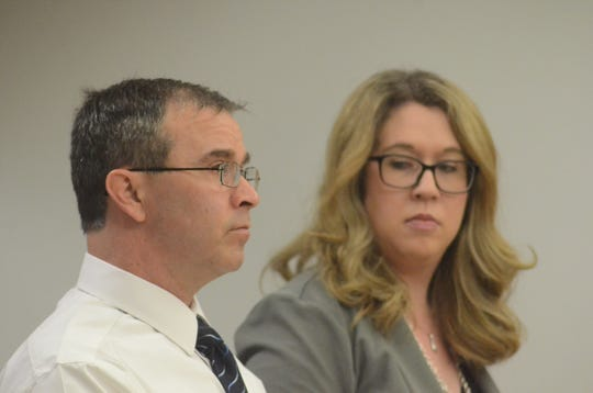 Scott Sayer appears with his attorney, Kimberly Wickham in court.