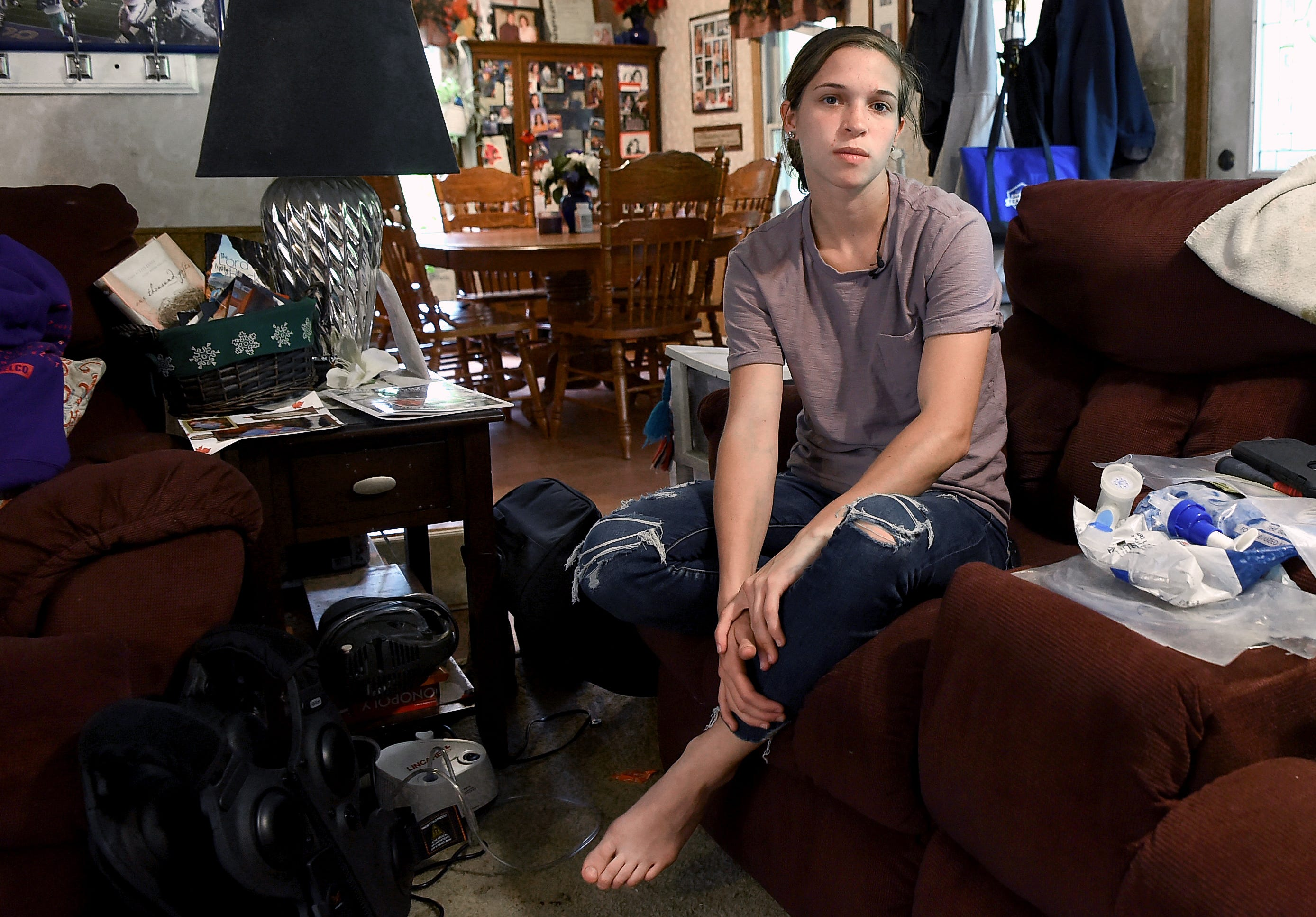 Emily Brown in her family's East Branch home on Tuesday, May 28, 2019. Diagnosed with with cystic fibrosis as a toddler, Emily must take 60 medications daily. Twice a day, she uses a $25,000 treatment vest to shake loose the excess mucus in her lungs.