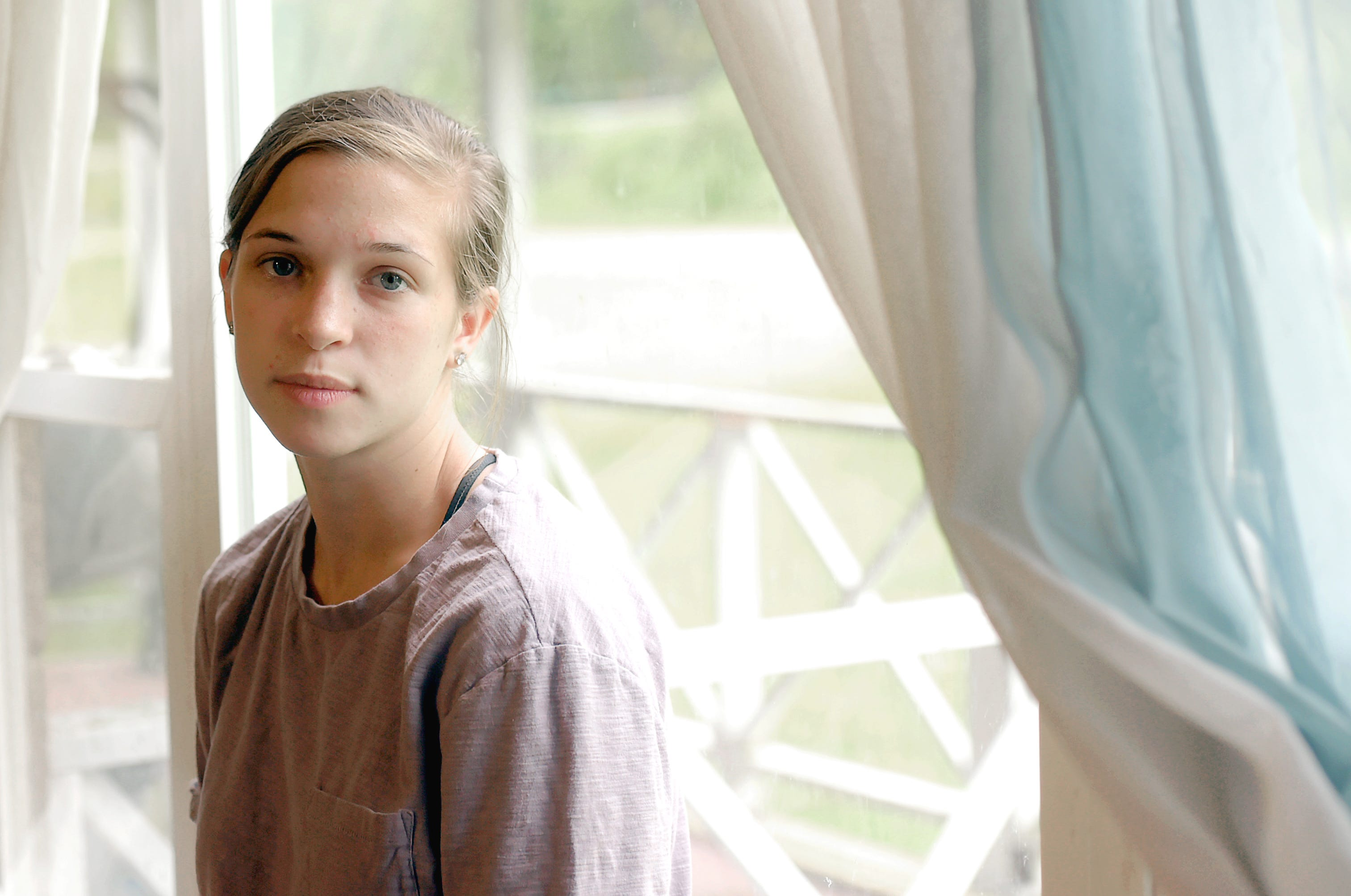 Emily Brown in her family's East Branch home on Tuesday, May 28, 2019. Both Emily and her older sister were diagnosed with cystic fibrosis when they still toddlers.