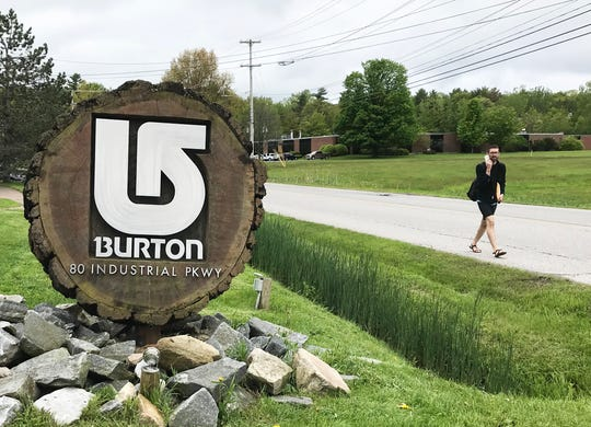 Brian Woychowski of Burlington walks past Burton Snowboards headquarters on Industrial Parkway on Wednesday, May 29, 2019. The road's name was changed to Queen City Park Road on July 1.