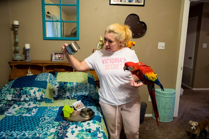 Dedra Benedict prepares to feed her birds on April 30, 2019. She grew up terrified of birds, but when she moved to Corpus Christi four years ago she and her husband got a membership to the South Texas Botanical Gardens & Nature Center and she began visiting several times a week to help her get over her fear. Now she has five birds of her own and also cares for two of the gardens birds at her home.