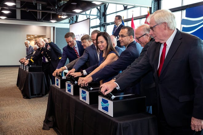Elected, military and public officials pull a lever during the celebration of the commencement of the Port of Corpus Christi Ship Channel Improvement Project on Wednesday, May 29, 2019 at the Congressman Solomon P. Ortiz International Center. The $380 million project is the culmination of 30 years of discussion to deepen the channel to accommodate larger vessels.