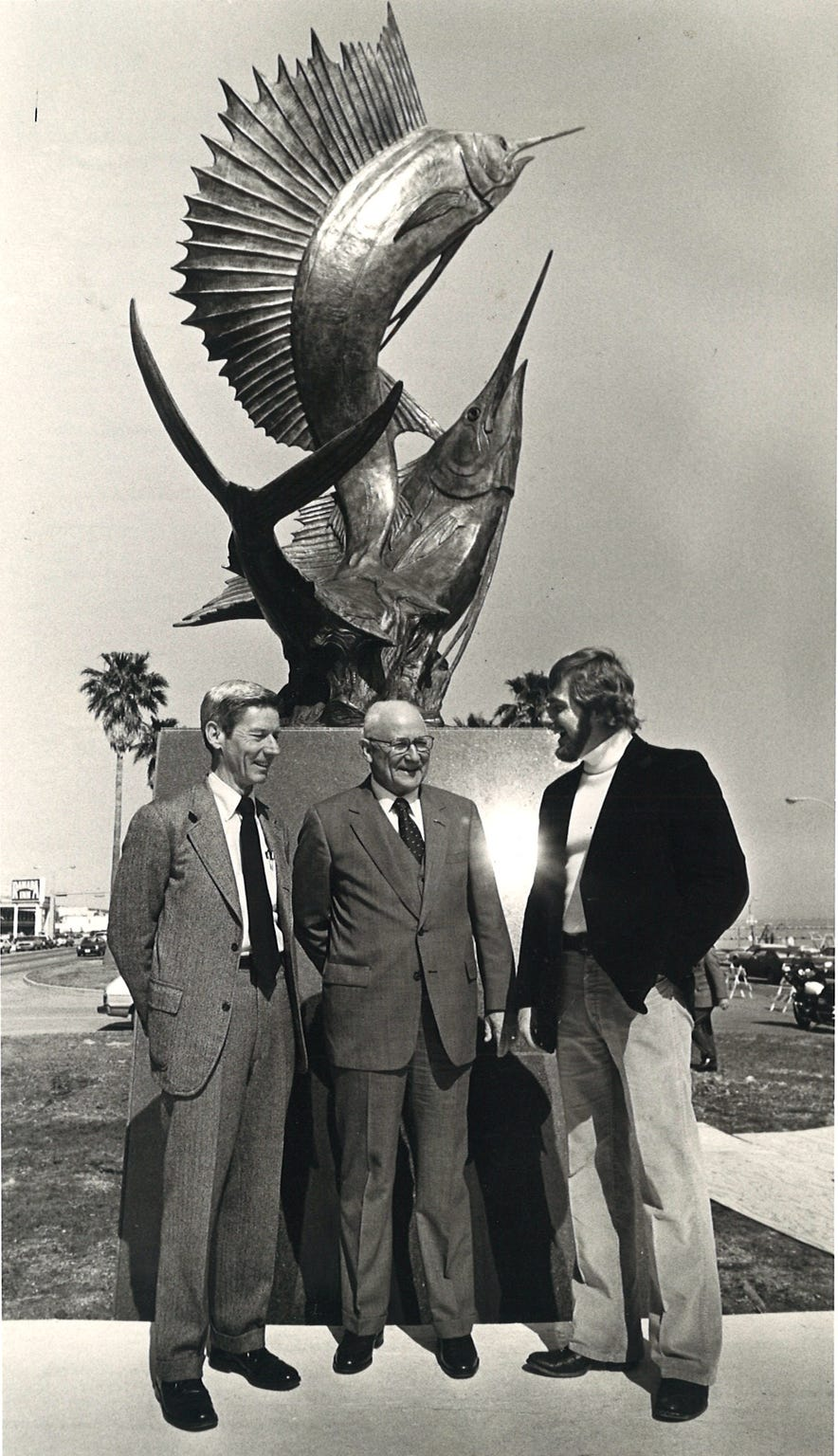 "Caller-Times publisher Ed Harte (left to right), Corpus Christi Mayor Luther Jones, and sculptor Kent Ullberg stand in front of Ullberg's sculpture ""Wind in the Sails"" in January 1983. The Caller-Times commissioned and dedicated the art to the city to celebrate the newspaper's 100th anniversary. The sculpture is in the median between the north and south lanes of Shoreline Blvd. on the Corpus Christi bayfront."