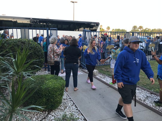 Texas A&M-Kingsville softball players are greeted by fans after returning from the Women's College World Series on Tuesday, May 28, 2018 in Kingsville.