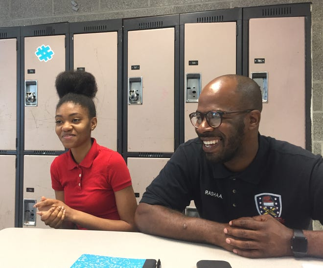 Kihirha Coleman (left) talks about her business plan, a nonprofit to give college-bound students a basket of dorm supplies during a Young Moguls session with Rashaan Hornsby.