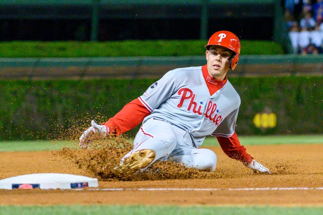 May 21, 2019; Chicago, IL, USA; Philadelphia Phillies center fielder Scott Kingery (4) slides into third base during the seventh inning against the Chicago Cubs at Wrigley Field. Mandatory Credit: Patrick Gorski-USA TODAY Sports