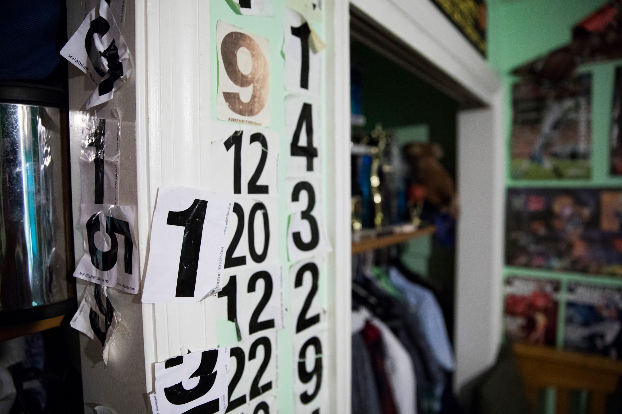 Tucker's running numbers line his bedroom closet in South Salem, Ohio. He has collected them for as long as he can remember.