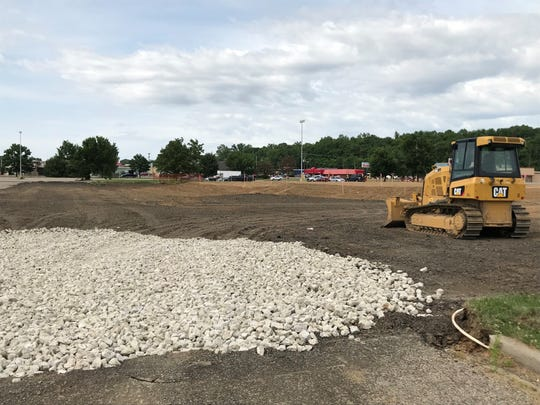 A dirt mound with flags marks the location of the new Texas Roadhouse location on North Bridge Street. The restaurant chain was approved to construct foundation, slabs and walls with the Ross County Planning and Building departments.