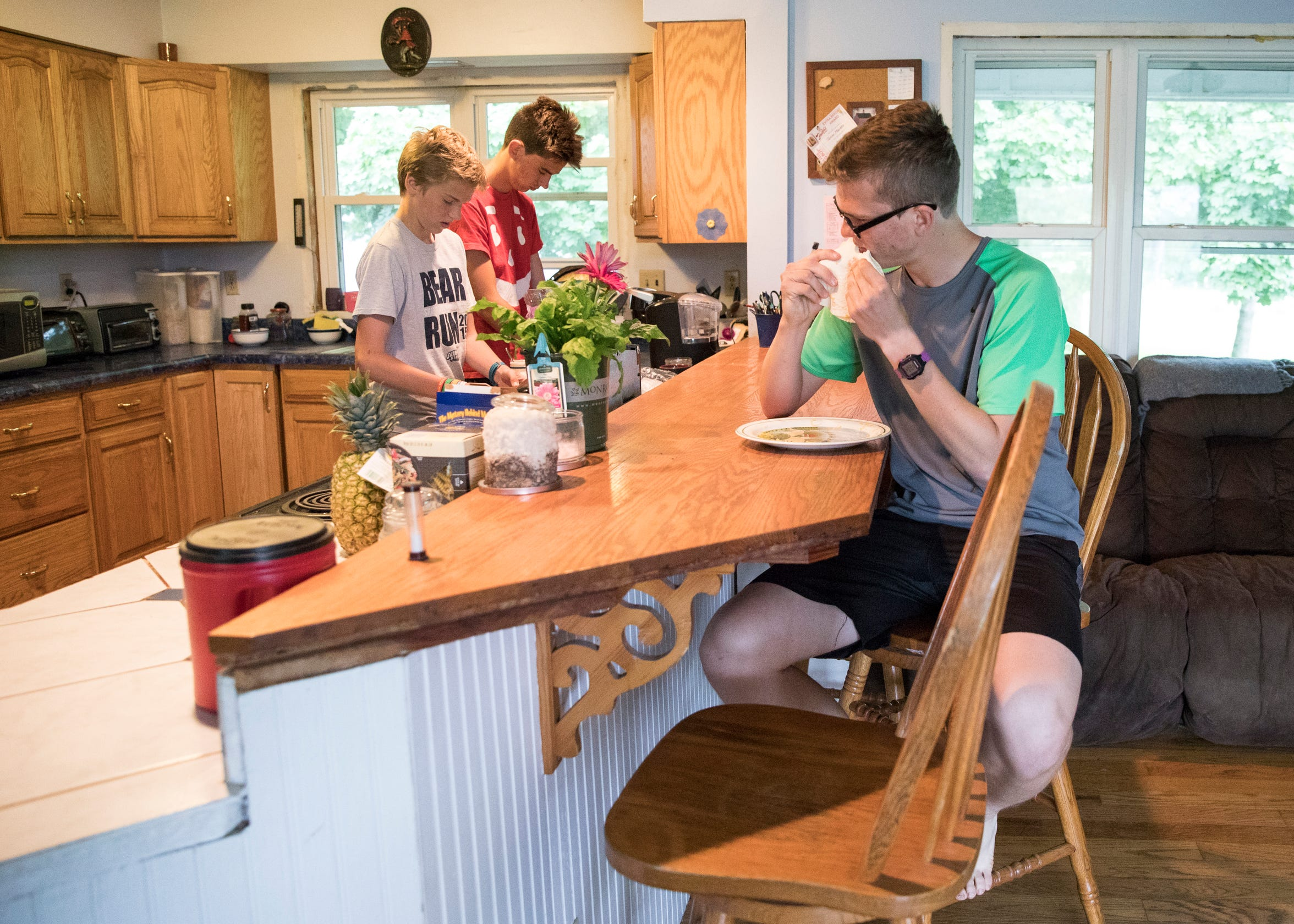 Tucker Markko fixes something to eat with his brothers Cater and Turner before they go out on a Sunday afternoon run in South Salem, Ohio.