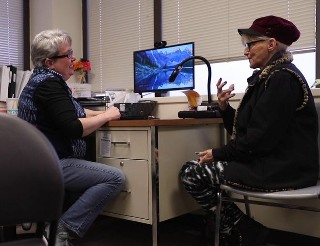 Mental Health Deaf Services Specialist Deborah Mann works with a client at the organization's Roselawn office.