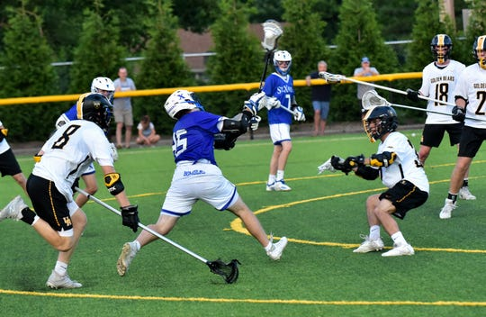 Noah Reidy of St. Xavier heads to the goal for the game winning shot in overtime as the Bombers top Upper Arlington 9-8 at the OHSAA Division I lacrosse state semifinal on May 28, 2019.