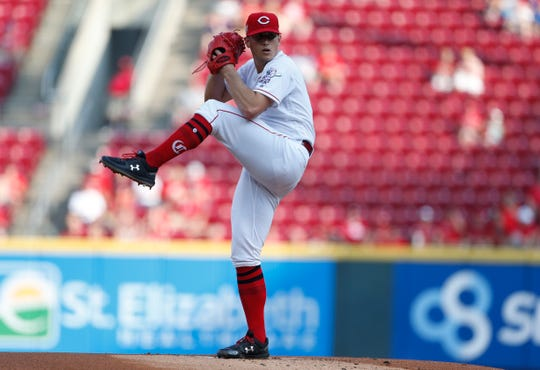 Cincinnati Reds starting pitcher Lucas Sims throws against the Pittsburgh Pirates during the first inning of a baseball game, Tuesday, May 28, 2019, in Cincinnati.