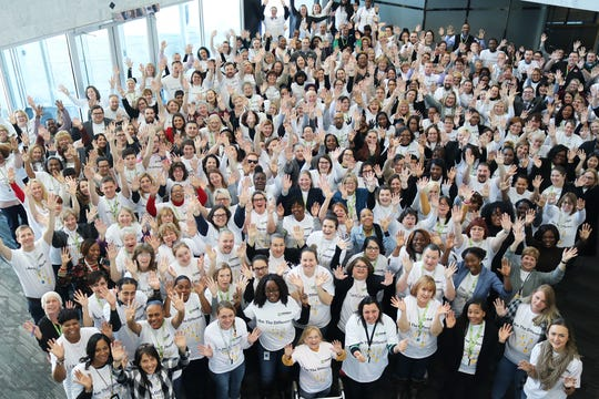 "Ensemble means team! Ensemble employees gather in the lobby to show off their new ""I am the Difference"" t-shirts."