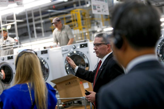 An LG representative shows the main assembly line at the grand opening of the LG Clarksville plant May 29, 2019.