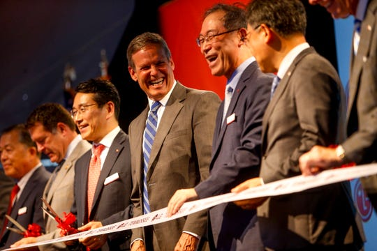 Tennessee Governor Bill Lee laughs with other executives and officials before cutting the ribbon at the grand opening of the LG Clarksville plant in Clarksville, Tenn., on Wednesday, May 29, 2019.