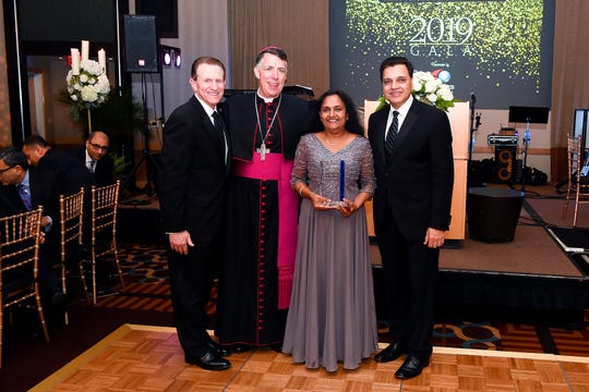Pictured at the Saint Peter's Foundation gala event are (left to right) Leslie D. Hirsch, FACHE, interim CEO and president, Saint Peter's Healthcare System; the Most Reverend James F. Checchio of the Roman Catholic Diocese of Metuchen; Meena Murthy, MD, FACE, chief, Division of Endocrinology, Nutrition and Metabolism at Saint Peter's University Hospital and recipient of the Physician Appreciation Award, and Niranjan Rao, MD, vice president and chief medical officer, Saint Peter's Healthcare System.
