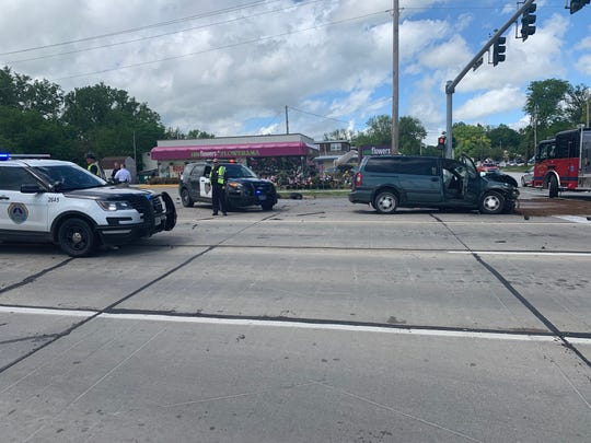 Windsor Heights and Des Moines authorities investigate a crash Wednesday, May 29, 2019 during which a motorist fleeing police hit three separate cars, including the van seen here.