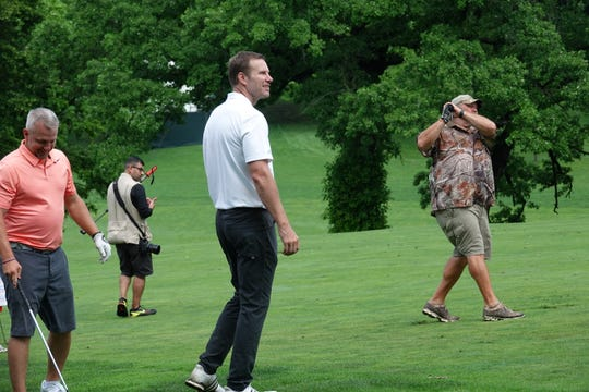 Nebraska basketball coach Fred Hoiberg watches an approach shot from comedian Larry the Cable Guy during a pro-am Wednesday at Wakonda Club in Des Moines as part of the Principal Charity Classic.