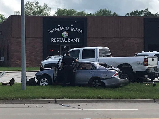 A car that lead police on a chase sits damaged after colliding with other vehicles on 73rd Street and University Avenue near the western border of Des Moines on Wednesday, May 29, 2019. The driver of the car reached speeds over 80 MPH while fleeing on the interstate during the chase.