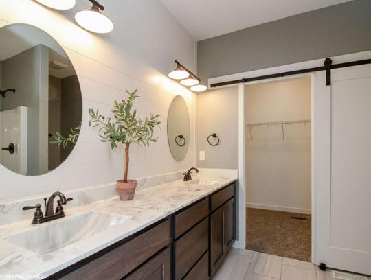 One of the two bathrooms in this 3-bedroom 1600 sq. ft. home.