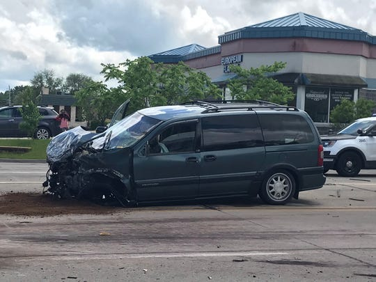 A van sits damaged on 73rd Street and University Avenue near the western border of Des Moines after being struck by another vehicle fleeing police on Wednesday, May 29, 2019.