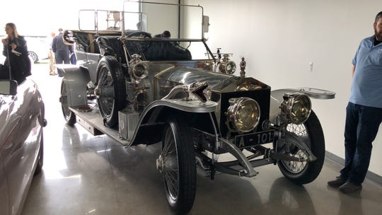 Rare 1909 Rolls Royce Silver Ghost shelters from rain at the preview for the Concours d'Elegance of America, which takes place in Plymouth, July 28.