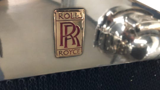Rolls-Royce badges had red letters before the death of co-founder Henry Royce, when the color changed to black in mourning. Before he died, Royce favored changing to black because red type clashed with the colors of some vehicles.