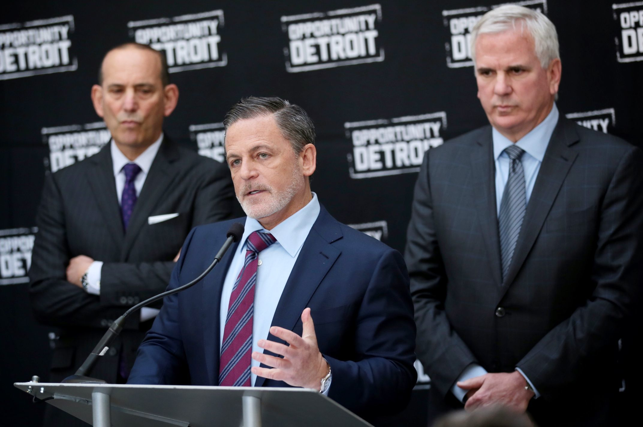 Quicken Loans founder Dan Gilbert, center, and Matt Cullen, president and CEO of Rock Ventures, right, appear during a press conference on  April 27, 2016, to announce a partnership to bring a Major League Soccer club to Detroit. At left is MLS Commissioner Don Garber.