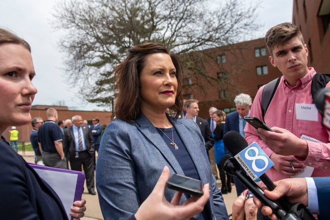 Michigan Governor Gretchen Whitmer speaks with media after the groundbreaking ceremony of the upcoming Grand Rapids Home for Veterans on Friday, May 17, 2019, in Grand Rapids, Mich.