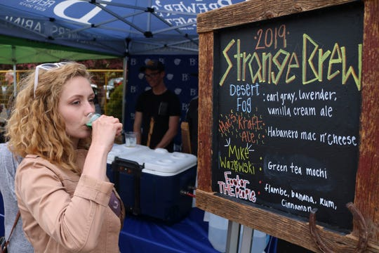 A woman tastes a green tea mocha beer at the Strange Brew Festival in Reno, Nev.
