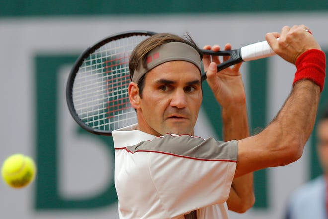 Roger Federer plays a shot against Oscar Otte during their second-round match of the French Open on Wednesday at the Roland Garros stadium in Paris.