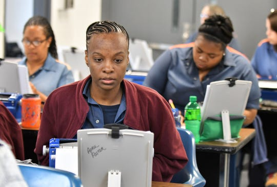 April Foster, 38, and other inmates work on their manuscripts, transcribing novels into braille to become certified by the Library of Congress, at the Women's Huron Valley Correctional Facility in Ypsilanti, Mich. on May 28, 2019.  Twenty inmates have been learning to transcribe braille and seven have passed their first certification.
